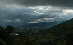 dramatic storm clouds over a small caribbean mountain town of Ocoa, dominican Republic.