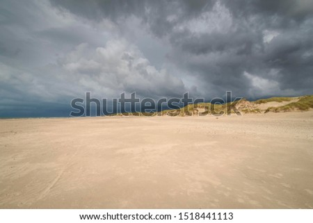 Dramatic storm clouds over beach and dunes, Henne Strand, Region of Southern Denmark, Denmark #1518441113