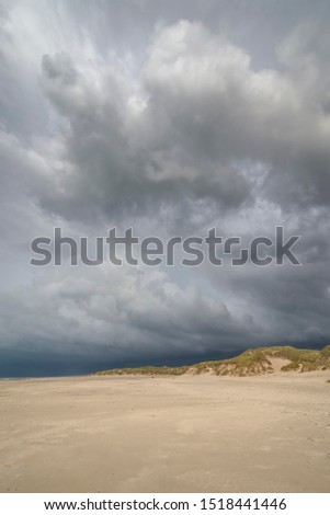 Dramatic storm clouds over beach and dunes, Henne Strand, Region of Southern Denmark, Denmark #1518441446
