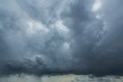 Dramatic storm cloudscape, with strange cloud shapes and rain