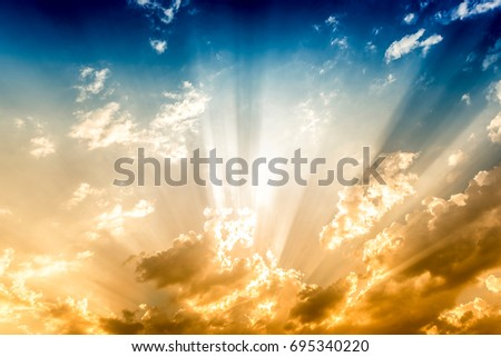 Dramatic sun rays and clouds as background  #695340220