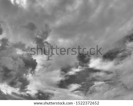 Dramatic sunlight of  sky and clouds in Black and White. Black and white clouds texture on the dark sky background abstract. #1522372652