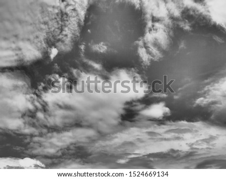 Dramatic sunlight of  sky and clouds in Black and White. Black and white clouds texture on the dark sky background abstract. #1524669134