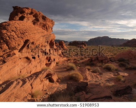 Dramatic sunrise and red sandstone formations at Valley of Fire Nevada.