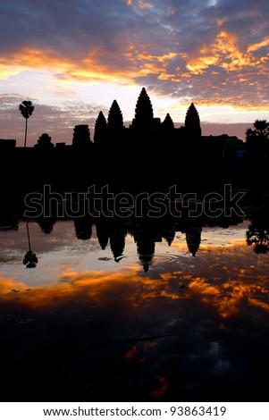 Dramatic sunrise at Angkor Wat and reflecting pool, near Siem Reap, Cambodia - stock photo
