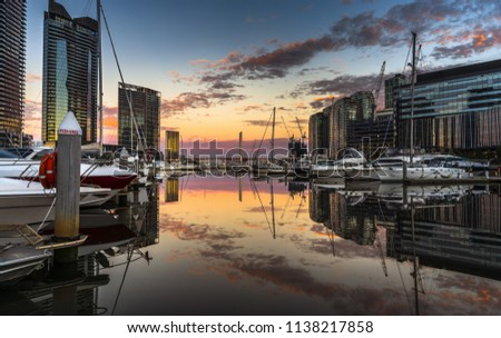 dramatic sunrise docklands south wharf Melbourne reflections calm bay colourful sky yachts