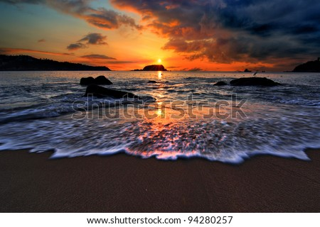 Dramatic sunrise on a Pacific coast beach in Mexico