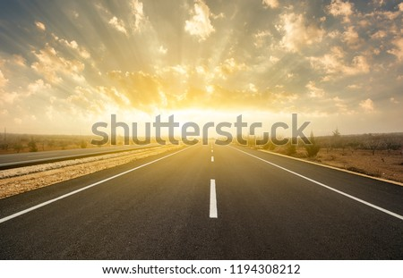 dramatic sunrise on asphalt road