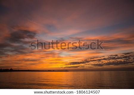 Dramatic sunrise over the river. Orange sunrise Photo stock ©