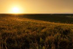 Dramatic sunrise photo at the Kansas Tallgrass Prairie Preserve Park.
