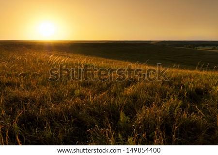 Dramatic sunrise photo at the Kansas Tallgrass Prairie Preserve Park. ストックフォト ©