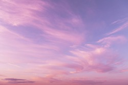 Dramatic sunrise, sunset pink violet sky with clouds background texture