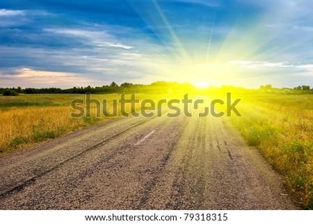 dramatic sunset and asphalt road