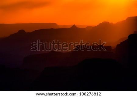Dramatic sunset at Grand Canyon ridge