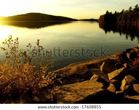 Dramatic sunset at lake. Autumn, October. Algonquin Provincial Park, Ontario, Canada.