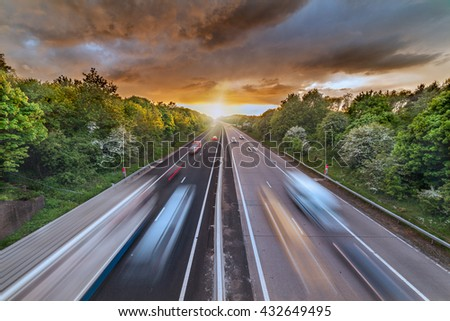 Dramatic Sunset Clouds over Busy Motorway #432649495