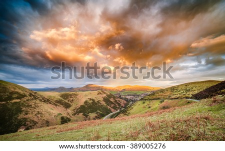 Dramatic Sunset Clouds Over Carding Mill Valley, Shropshire Hills UK #389005276