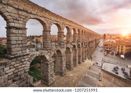 Dramatic sunset in famous Segovia aqueduct, Castilla y leon, Spain. stock photo