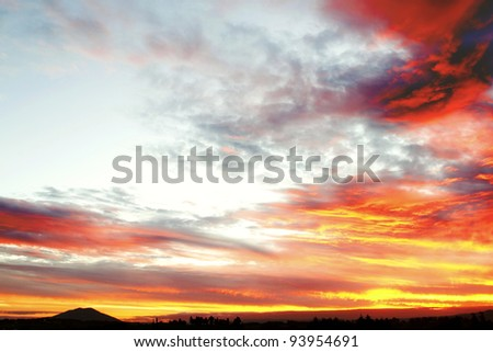 Dramatic sunset in sky over landscape