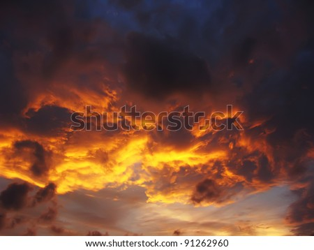 Dramatic sunset like fire in the sky with golden clouds