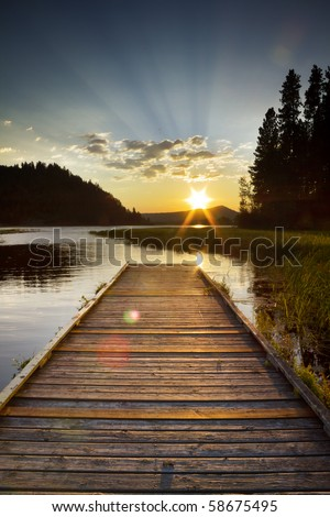 dramatic sunset of a lake looking off a dock