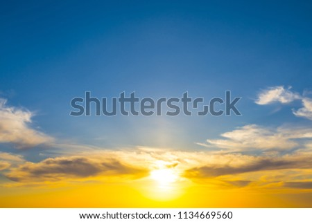 dramatic sunset on a blue sky background #1134669560