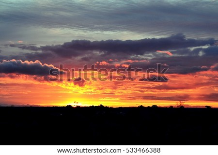 Shutterstock Dramatic sunset, orange, red, purple sky