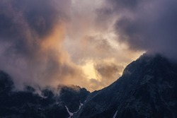 Dramatic sunset over a moutain alpine like landscape of High Tatras, Slovakia. Rugged rocky mountains during spectacular sunset or sunrise. High peaks of Tatra mountains.