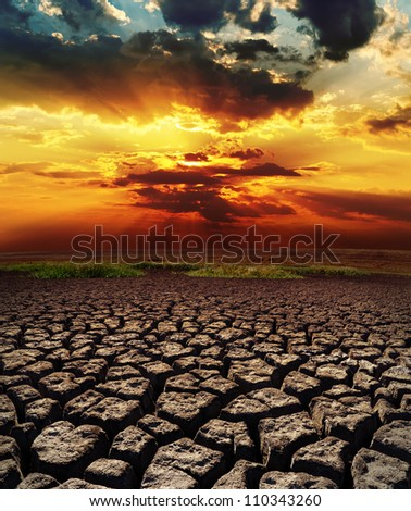 dramatic sunset over drought land