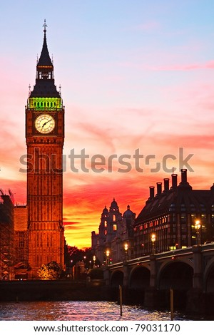 Dramatic sunset over famous Big Ben clock tower in London, UK.