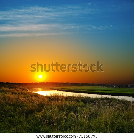 dramatic sunset over river