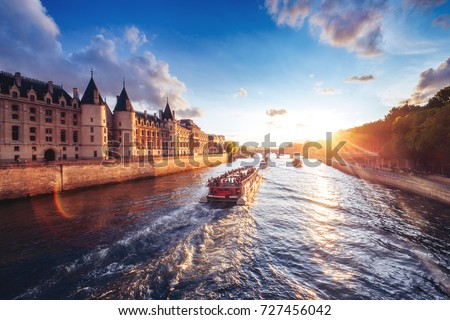 Dramatic sunset over river Seine in Paris, France, with Conciergerie and Pont Neuf. Colourful travel background. Romantic cityscape. Stock photo ©