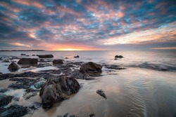 Dramatic sunset over the beach at Llandanwg near Barmouth on the north coast of Wales