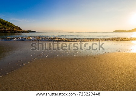 Dramatic sunset over the beach at Nha Trang beach - Vietnam Seascape #725229448