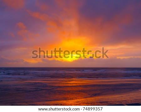Dramatic sunset over the ocean with brilliant sky and water colors