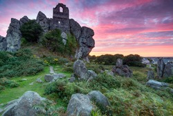Dramatic sunset sky over Roche Rock, the ruins of an ancient chapel perched on a rocky outcrop of granite at Roche near St Austel in Cornwall