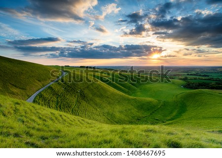 Dramatic sunset sky over The Manger at Uffington in Oxforshire, it is on the Ridgeway long distance walking route and forms part of the Berkshire Downs and on the border of Wiltshire Stock photo ©