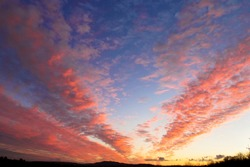 Dramatic sunset sky with pink clouds