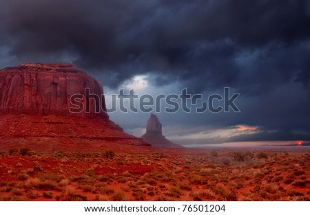 Dramatic thunderstorm during a sunrise in Monument Valley, Utah.