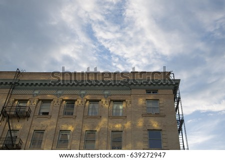 Dramatic Upward Skyward View, Tall Victorian City Apartment Building, Brick  Front, Ornate Dentil