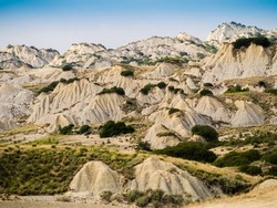 Dramatic view of Aliano badlands (calanchi), lunar landscape made of clay sculptures eroded by the rainwater, Basilicata region, southern Italy