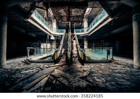 Dramatic view of damaged escalators in abandoned building. Apocalyptic and evil concept Stockfoto ©