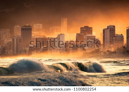 Dramatic View of Ipanema Beach and Buildings by Sunset With Ocean Drizzle in the Air and Strong Waves in Rio de Janeiro, Brazil