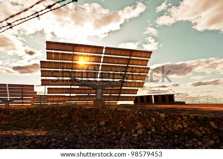 Dramatic View of Solar Panels at Sunset