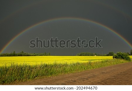 Dramatic view of storm weather conditions with the double rainbow, rainy day with the rainbow, double rainbow, dramatic scene after storm, rainbow and yellow field, Lithuania, lithuanian landscape
