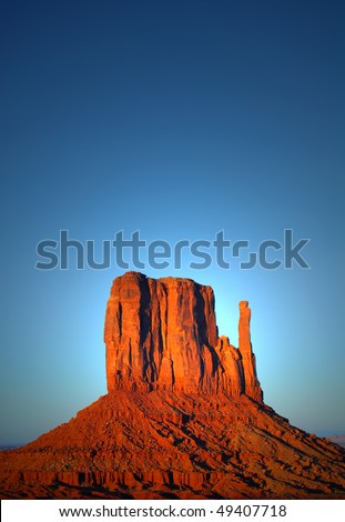 stock-photo-dramatic-view-of-the-mitten-in-the-navajo-park-monument-valley-at-sunset-49407718.jpg