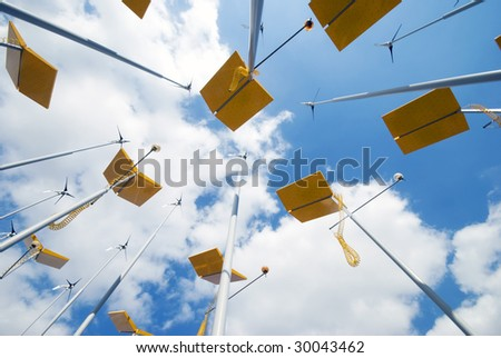 Dramatic view of wind turbines and solar panels