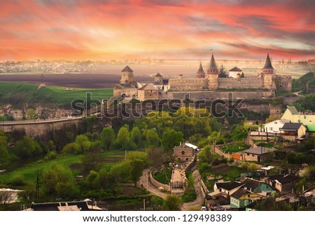 Dramatic view on the castle in Kamianets-Podilskyi in spring. Ukraine