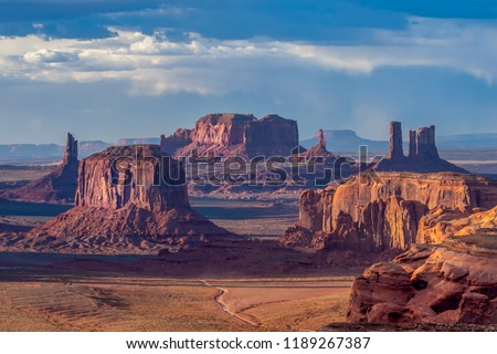 Dramatic views of Monument Valley in Navajo Nation with golden light at sunset   #1189267387