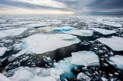 Dramatic wide angle view of melting  arctic sea ice floes breaking up taken at sea.Climate Crisis and Breakdown.Climate Emergency- Image